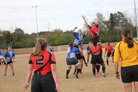 Caitlin Schlottman goes up for a lineout. Photo Credit: Nakia Lee