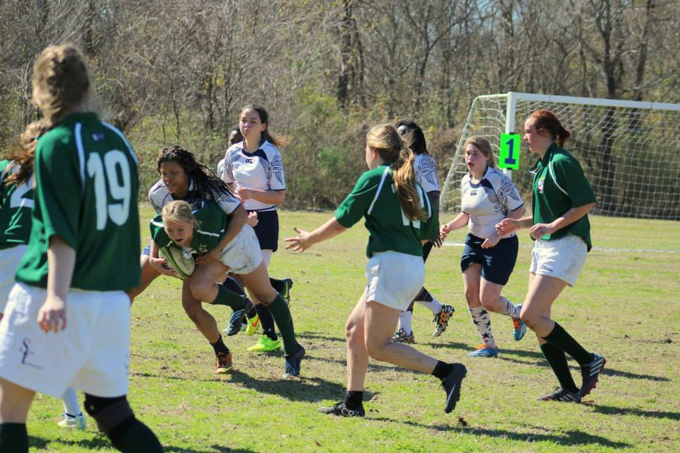 Oglesby makes a tackle during a game against Tulane. Photo Courtesy of Tulane Women's rugby.