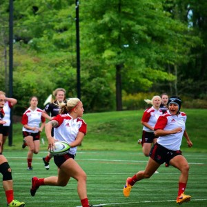 Byrge looks to make a pass off to her teammate. Photo Courtesy of Davenport University Rugby